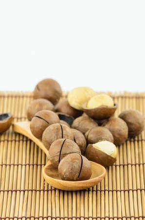 Macadamia Nuts on wooden spoon
