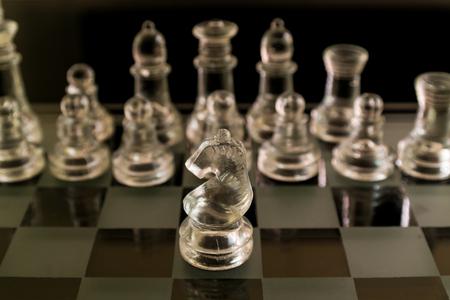 chess board: Glass Chess piece on board