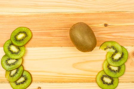 Fresh Kiwi fruit on wooden background