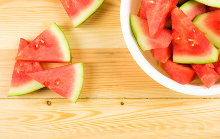 Watermelon sliced on wooden background Stock Photo