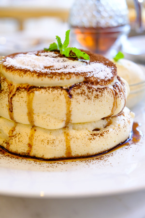 Pancakes topping with chocolate and syrup