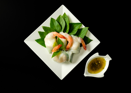Vietnamese Rolls with  Rice Noodeles and prawns on black background Stock Photo