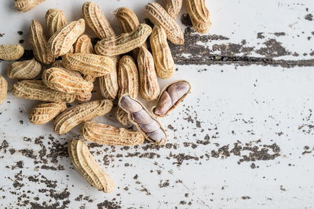 Peanuts on white wooden table