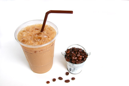 Iced coffee with straw in plastic cup on white background