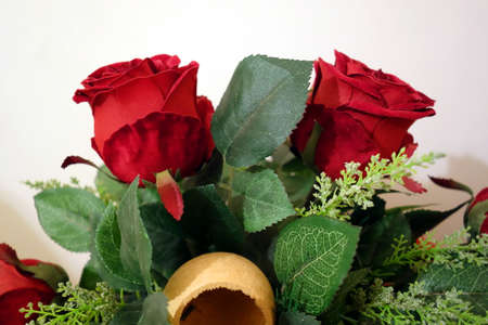 composition: Red artificial roses composition Stock Photo