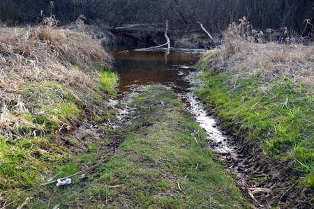 muddy: Muddy way through a river