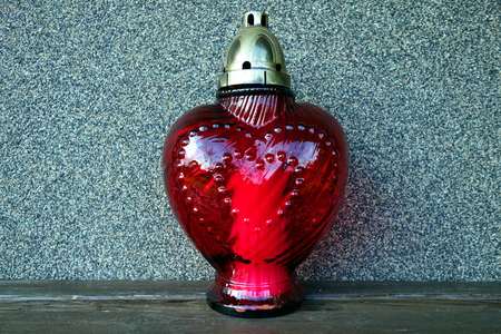 Red heart-shaped grave candle light