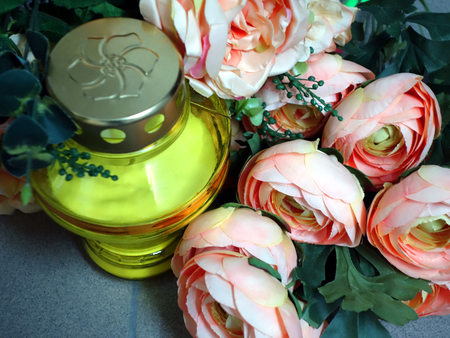 to pass away: Memorial candle light and flowers on the grave. All Saint`s Day. Stock Photo