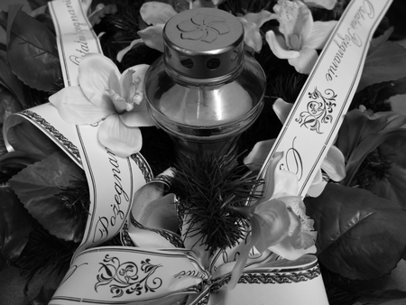 to pass away: Grave memorial wreath and candle. Funeral.