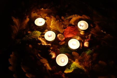 Memorial grave candles burn