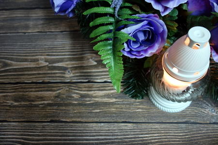 All Saint`s Day background with candle and wreath from roses blue, copy space