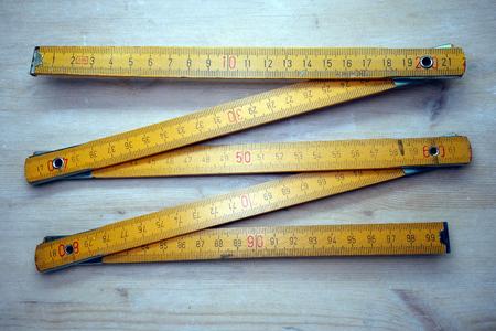 Folding ruler, vintage measurement tool Standard-Bild