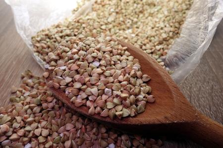Buckwheat groats in wooden spoon