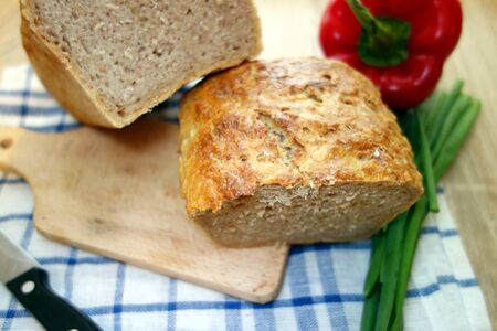 Traditional homemade bread on cutting board in the kitchen