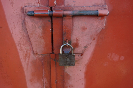 Padlock on a gate to secure storage
