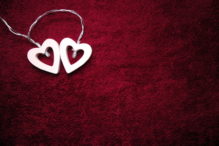 Valentine`s day concept with two hearts on burgundy background Stock Photo
