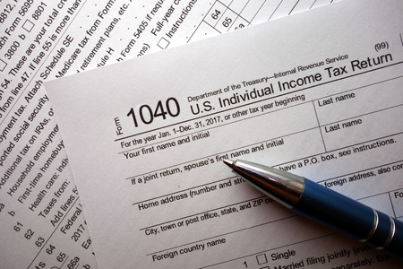 1040 tax form and a pen Stock Photo