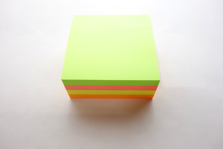 Colored stick notes stack on white background