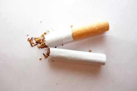 Broken cigarette on white background, stop smoking concept