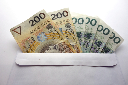 Polish zloty currency notes in white envelope