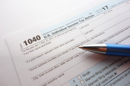 US form 1040 for year 2017, tax time 2018 concept