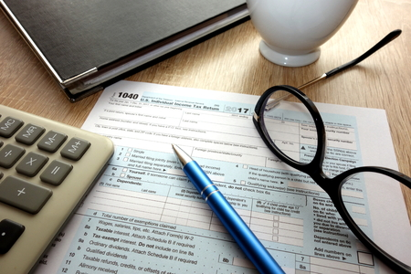 Blank 1040 form on desk in the office, taxation concept