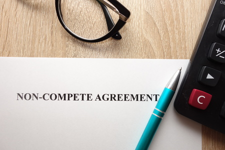 Non compete agreement form on desk