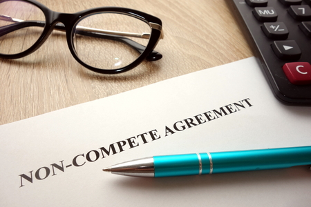 Non-compete agreement document for filling and signing on business competition concept