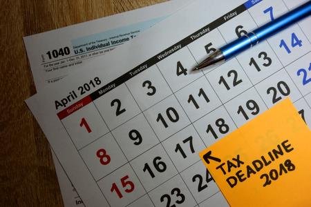 Calendar on US 1040 income tax form showing deadline filing as April 17 2018 Stock Photo
