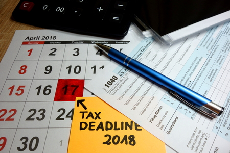 Calendar showing tax deadline for filing forms - april 17 2018