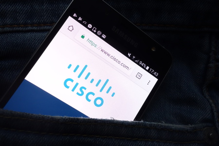 KONSKIE, POLAND - MAY 16, 2018: Cisco website displayed on Samsung smartphone hidden in jeans pocket