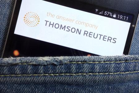 KONSKIE, POLAND - MAY 17, 2018: Thomson Reuters website displayed on smartphone hidden in jeans pocket