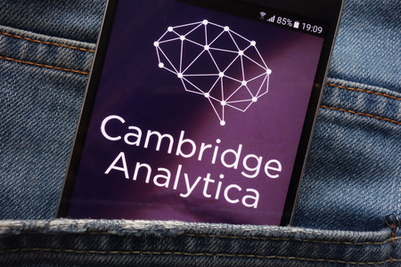 KONSKIE, POLAND - MAY 18, 2018: Cambridge Analytica website displayed on smartphone hidden in jeans pocket