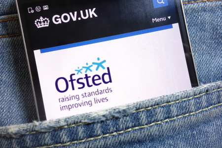 KONSKIE, POLAND - MAY 18, 2018: The Office for Standards in Education, Children`s Services and Skills (Ofsted) website displayed on smartphone hidden in jeans pocket