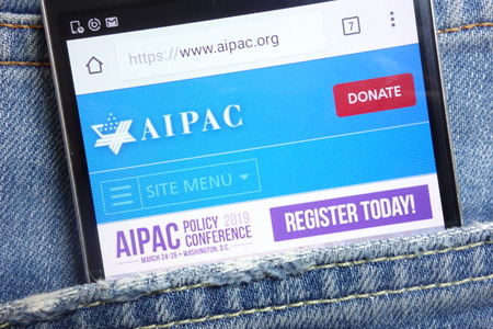 KONSKIE, POLAND - MAY 18, 2018: AIPAC website displayed on smartphone hidden in jeans pocket Editorial