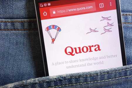 KONSKIE, POLAND - MAY 18, 2018: Quora website displayed on smartphone hidden in jeans pocket