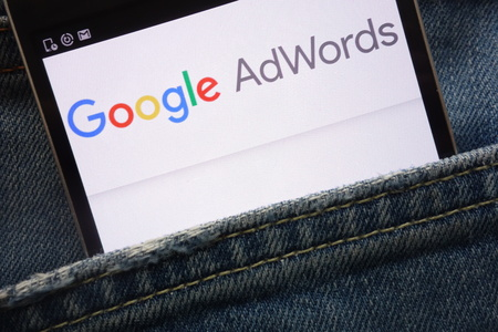 KONSKIE, POLAND - MAY 19, 2018: Google AdWords website displayed on smartphone hidden in jeans pocket Editorial