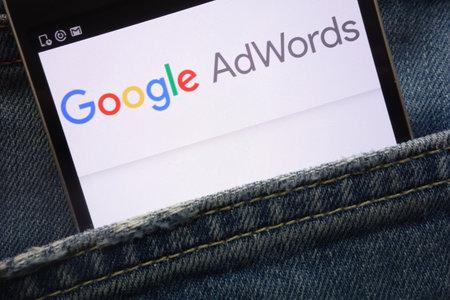 KONSKIE, POLAND - MAY 19, 2018: Google AdWords website displayed on smartphone hidden in jeans pocket Stock Photo - 104471515