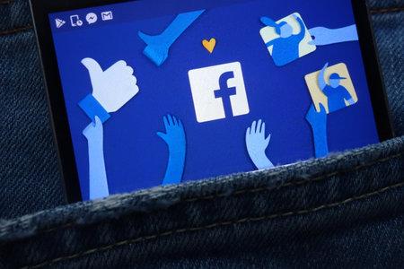 KONSKIE, POLAND - JUNE 01, 2018: Facebook logo displayed on smartphone hidden in jeans pocket Editorial
