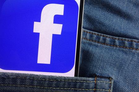KONSKIE, POLAND - JUNE 01, 2018: Facebook logo displayed on smartphone hidden in jeans pocket