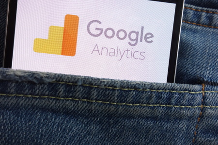 KONSKIE, POLAND - JUNE 01, 2018: Google Analytics logo displayed on smartphone hidden in jeans pocket