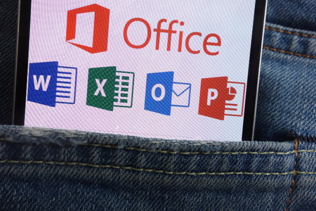 KONSKIE, POLAND - JUNE 01, 2018: Microsoft Office logo displayed on smartphone hidden in jeans pocket Editöryel