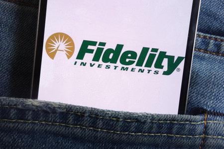 KONSKIE, POLAND - JUNE 01, 2018: Fidelity Investments logo displayed on smartphone hidden in jeans pocket