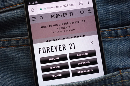 KONSKIE, POLAND - JUNE 02, 2018: Forever 21 website displayed on smartphone hidden in jeans pocket Redakční