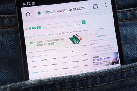 KONSKIE, POLAND - JUNE 02, 2018: Naver website displayed on smartphone hidden in jeans pocket
