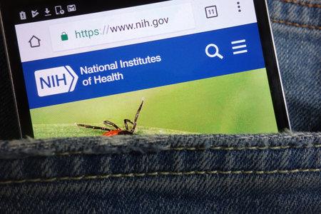 KONSKIE, POLAND - JUNE 02, 2018: National Institutes of Health (NIH) website displayed on smartphone hidden in jeans pocket