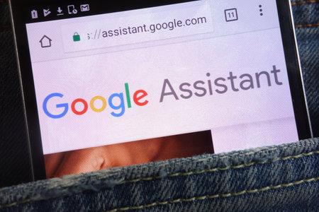 KONSKIE, POLAND - JUNE 02, 2018: Google Assistant website displayed on smartphone hidden in jeans pocket
