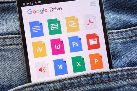 KONSKIE, POLAND - JUNE 09, 2018: Google Drive website displayed on smartphone hidden in jeans pocket