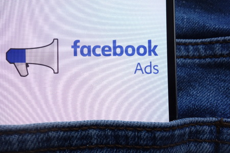 KONSKIE, POLAND - JUNE 11, 2018: Facebook Ads logo displayed on smartphone hidden in jeans pocket