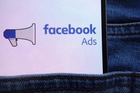 KONSKIE, POLAND - JUNE 11, 2018: Facebook Ads logo displayed on smartphone hidden in jeans pocket